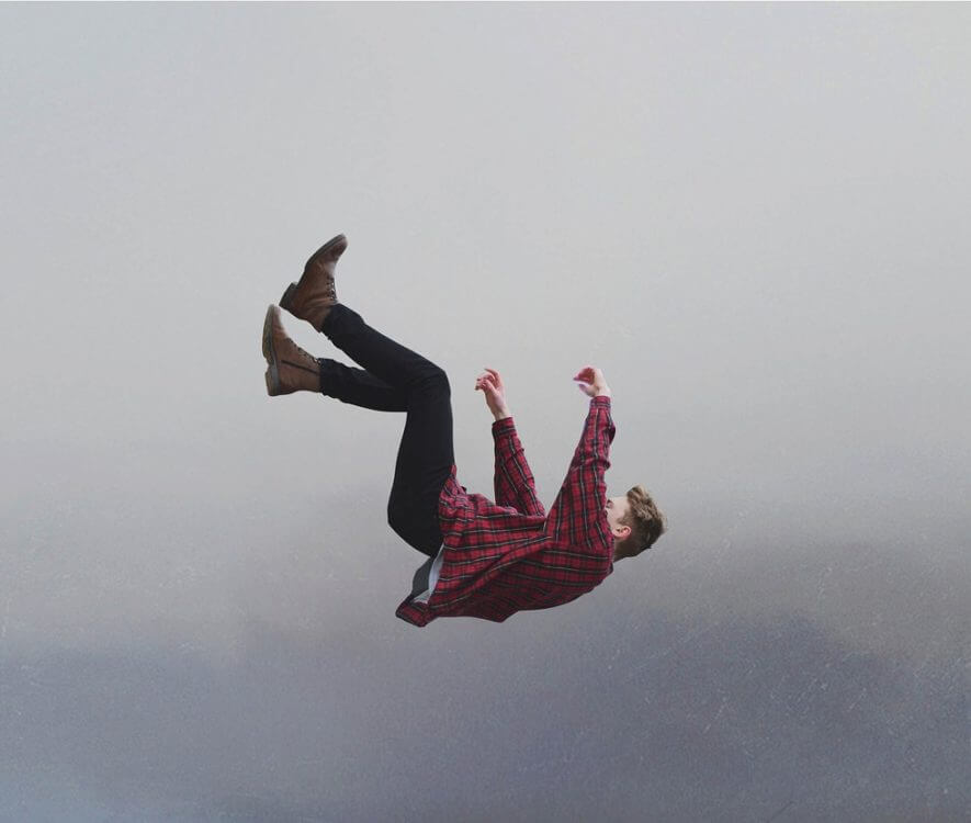 A man in a plaid shirt falling