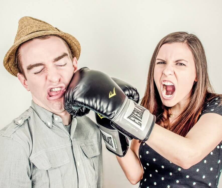 A woman punching a man in an argument